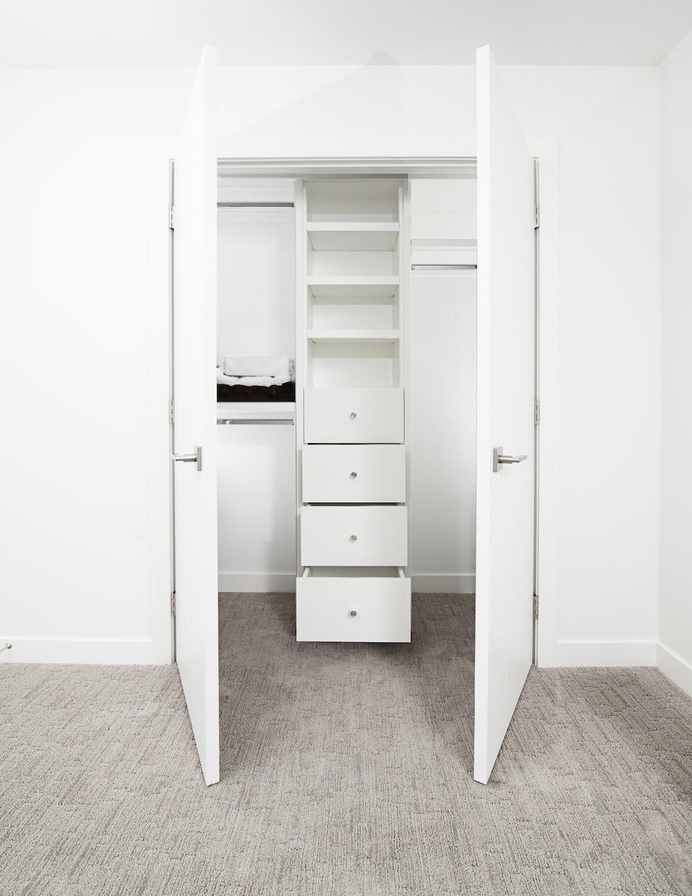 white wooden 2-door cabinet