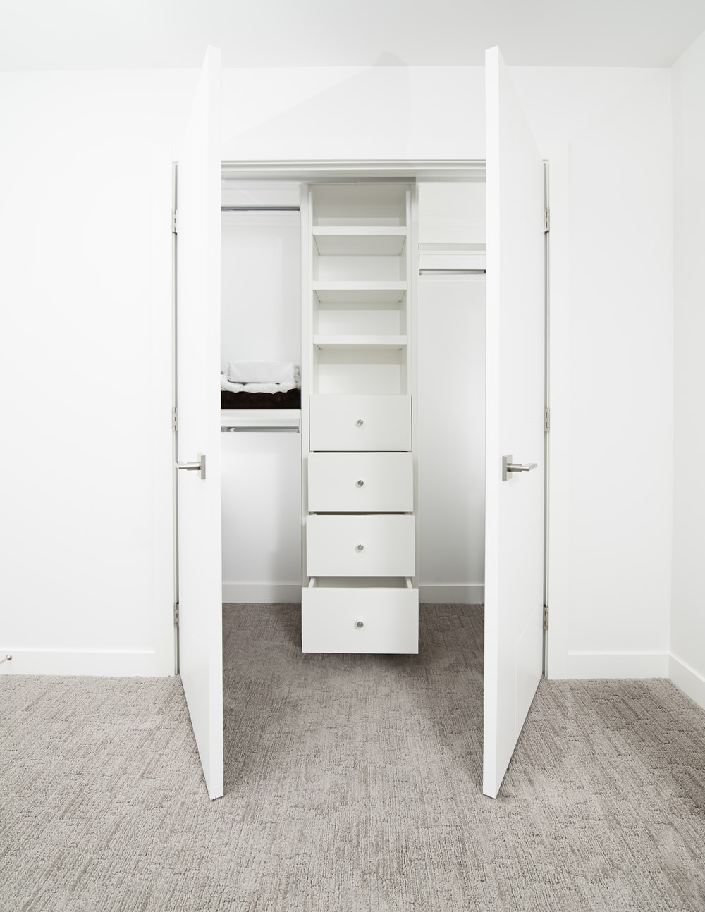 white wooden 2-door cabinet