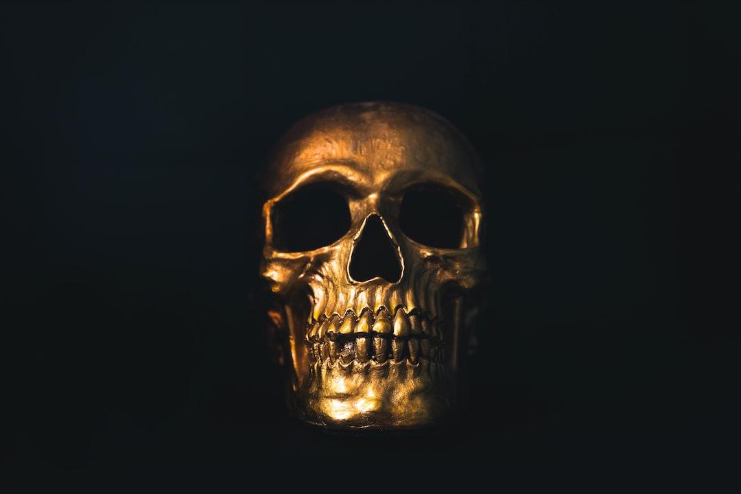 Gold skull on black background