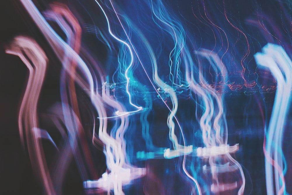 red blue and white lights streaking upwards