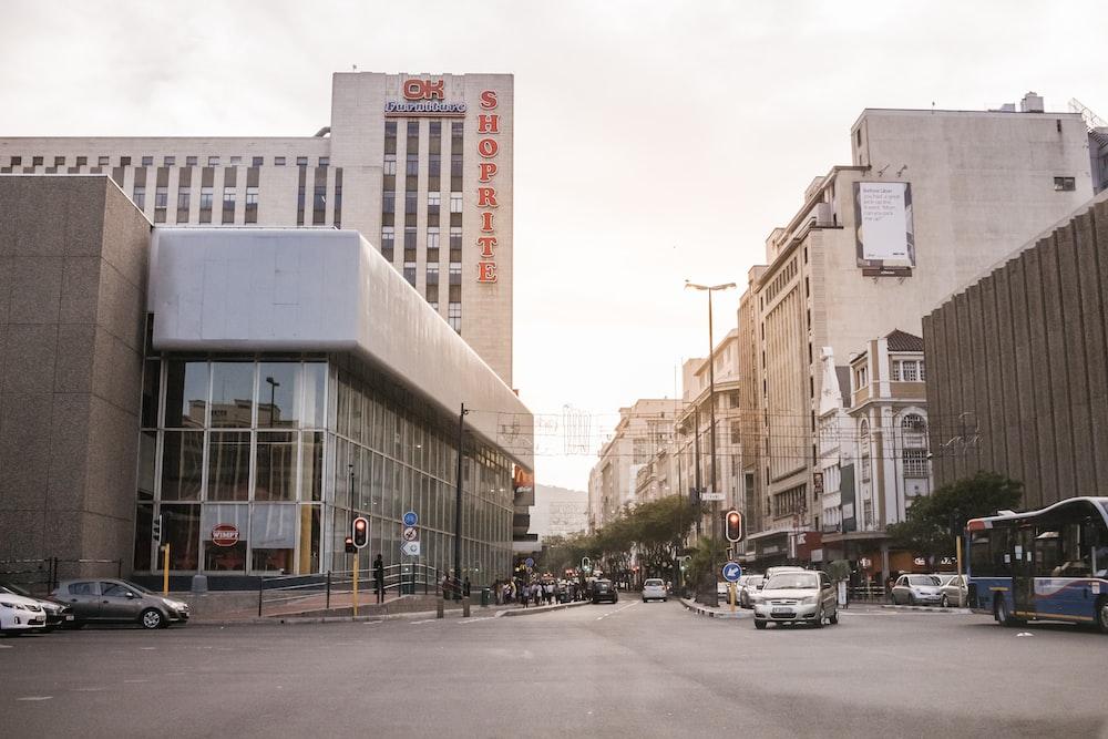 vehicles on street between buildings