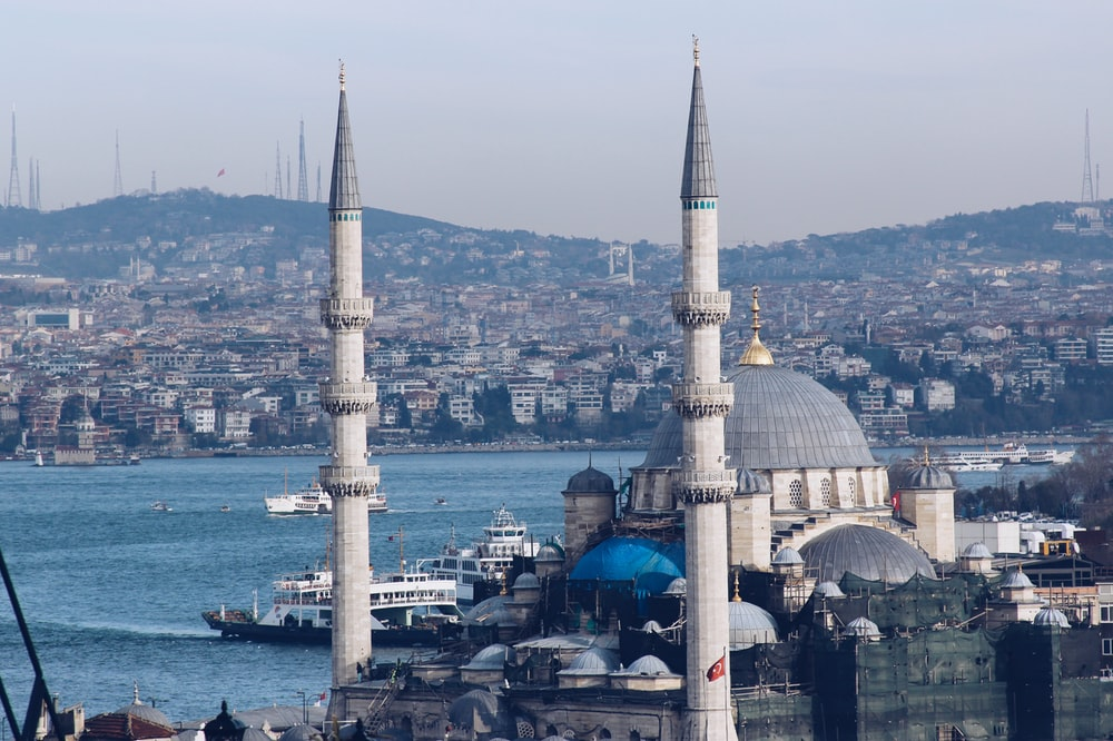 blue mosque near body of water