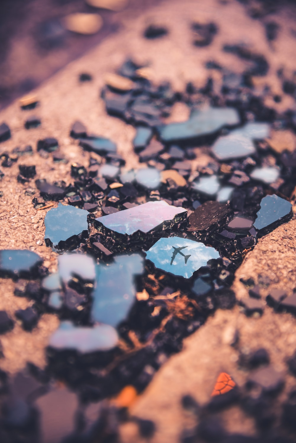 Macro Photography of broken rock with airliner reflection