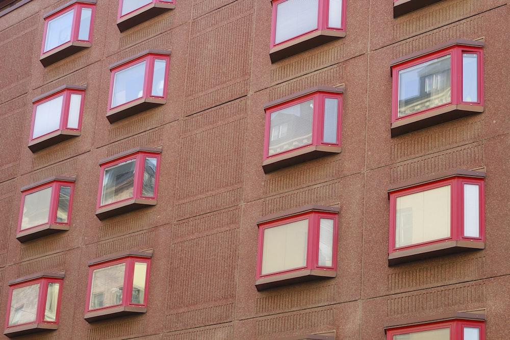 red framed glass window bi\uilding