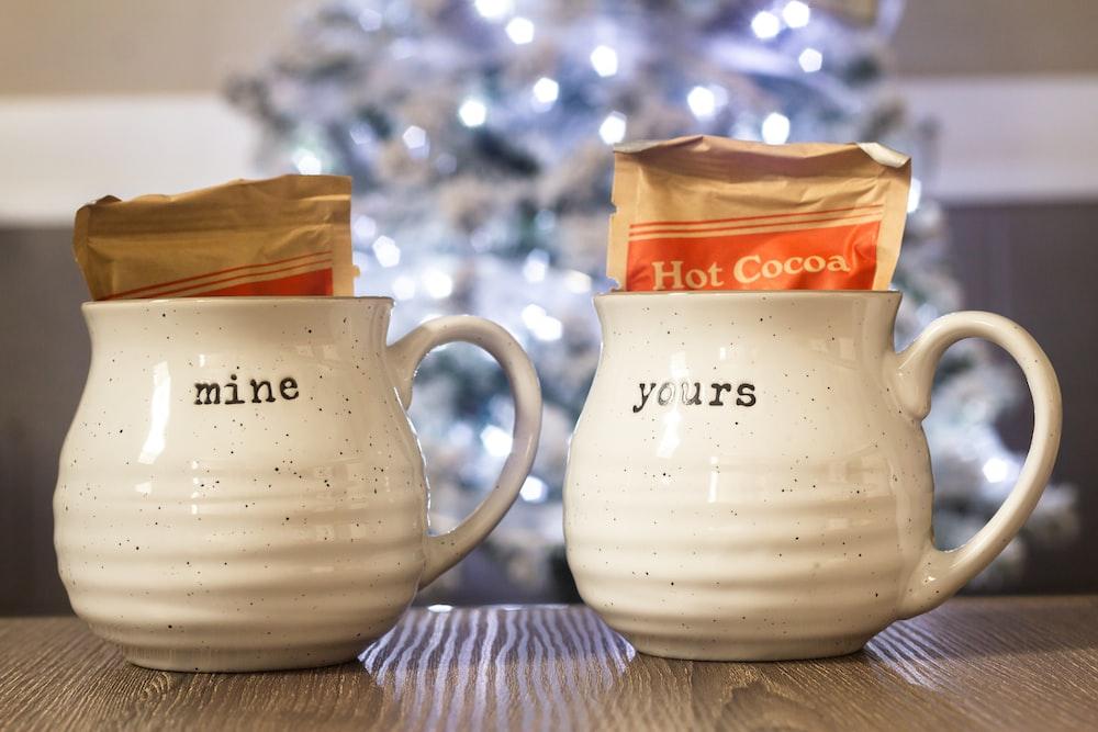 two shallow focus photo of white ceramic mugs