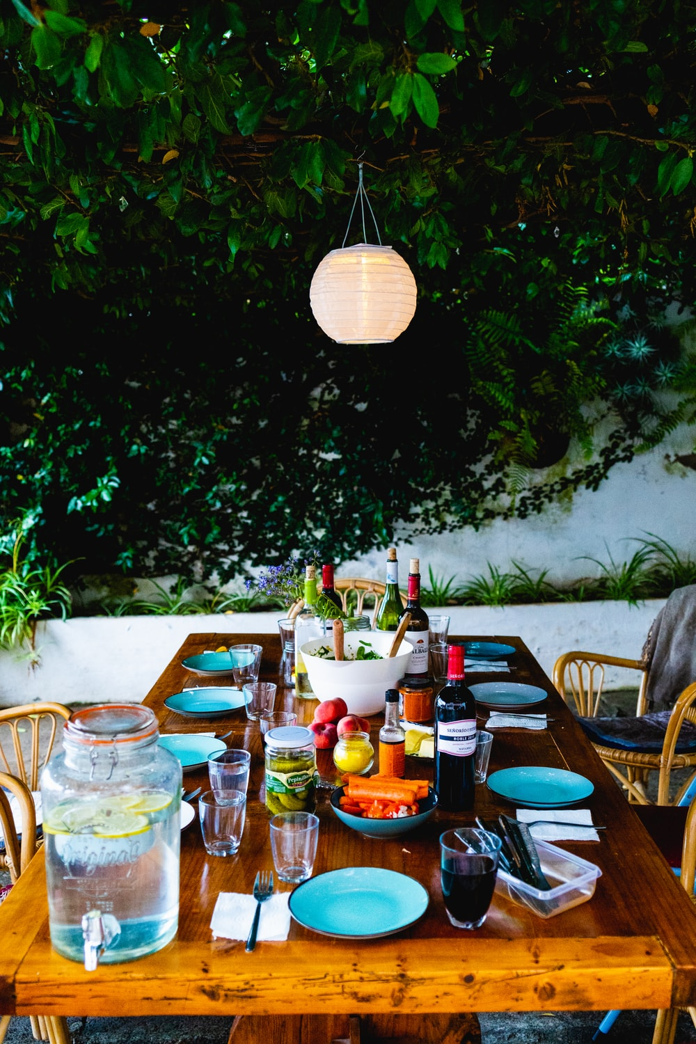 table set up beside green tree outdoors