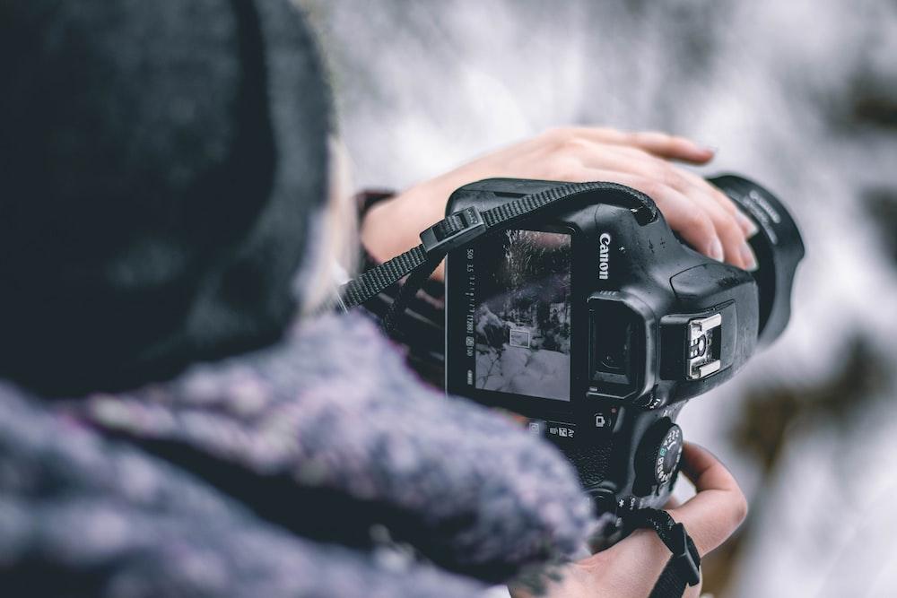 selective focus photography of DSLR camera