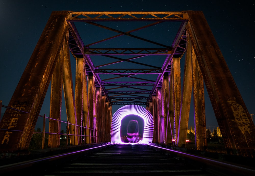 white neon lights on grey bridge