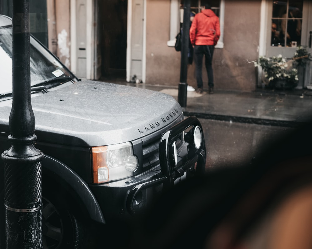 Land Rover parked near pole