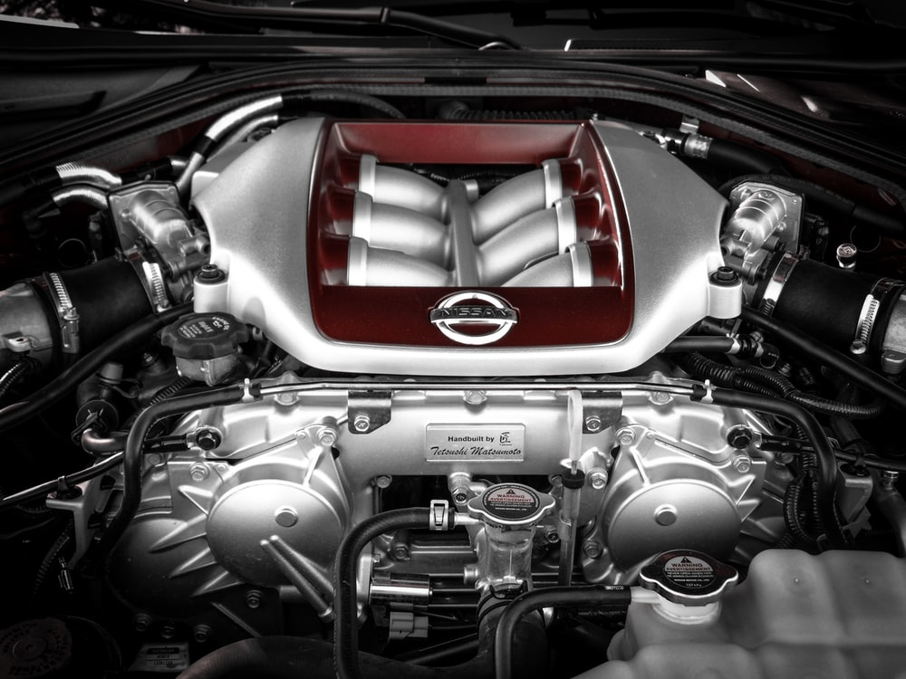 grey and red vehicle engine view