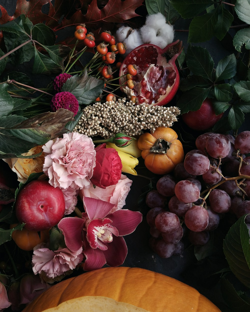 assorted fruits and flowers