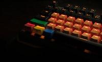 orange, black, and green mechanical keyboard