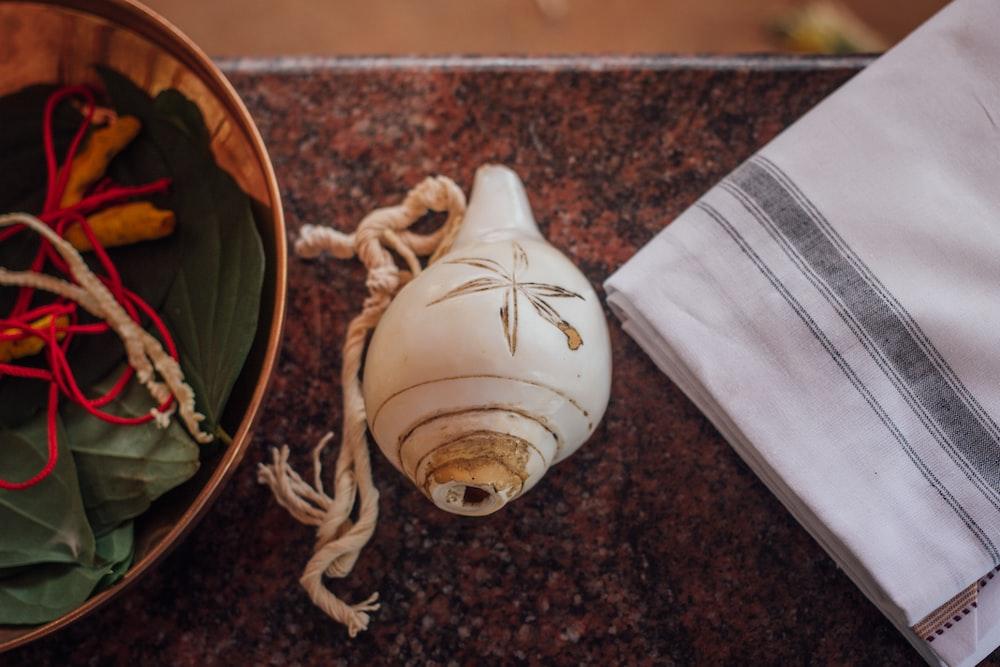 white seashell on table