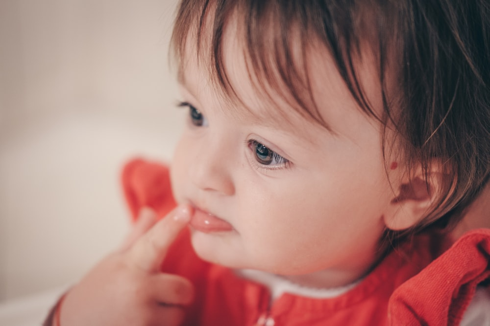 selective focus photography of toddler