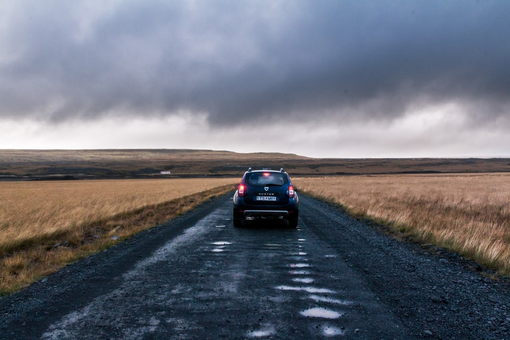 black Dacia Duster running on road during daytime