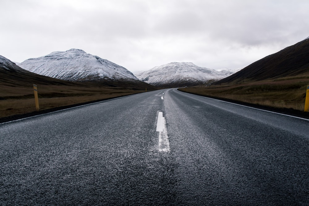asphalt road with mountain background