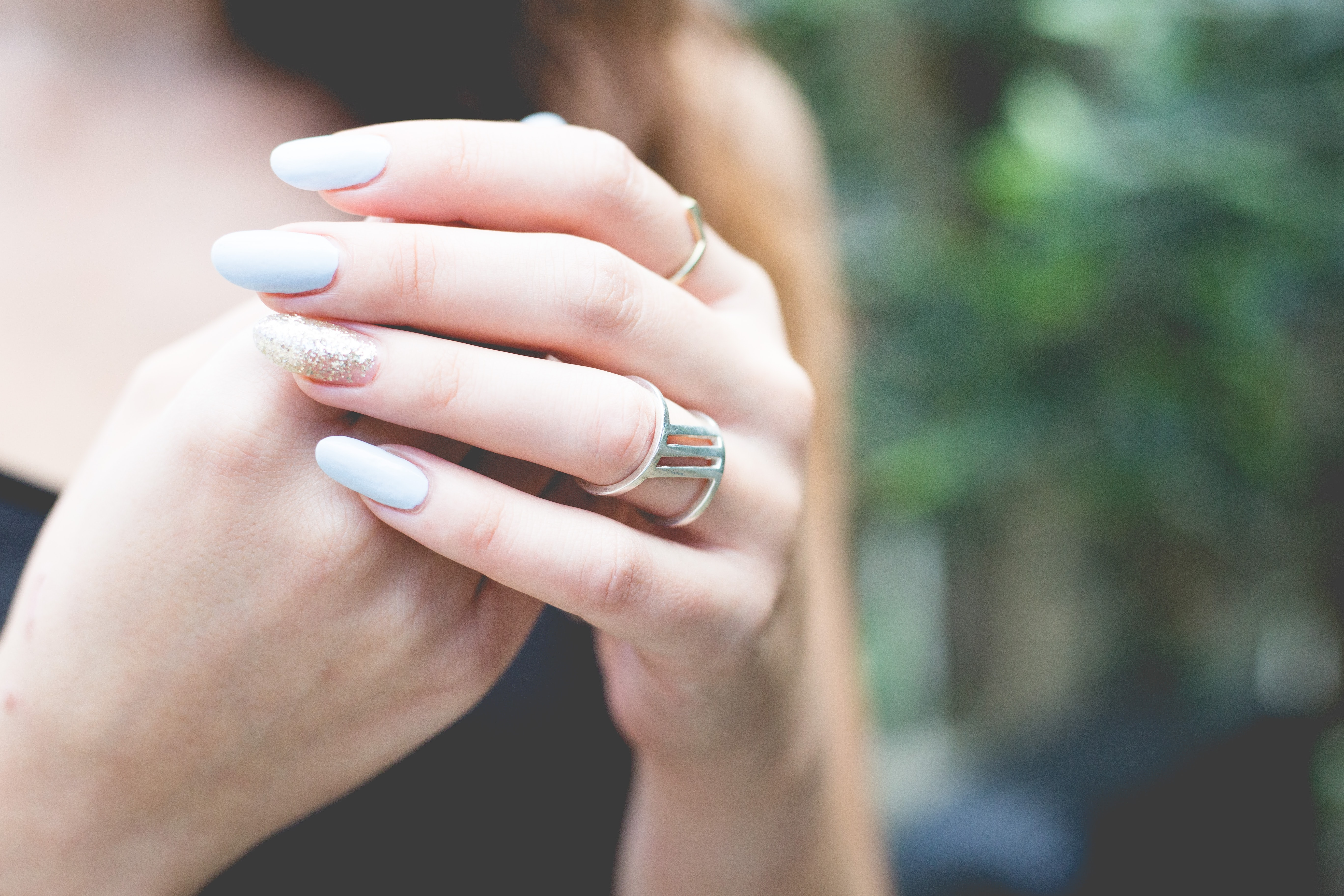 selective focus photography of woman wearing gold-colored ring