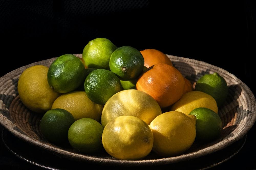 citrus fruits in brown bowl