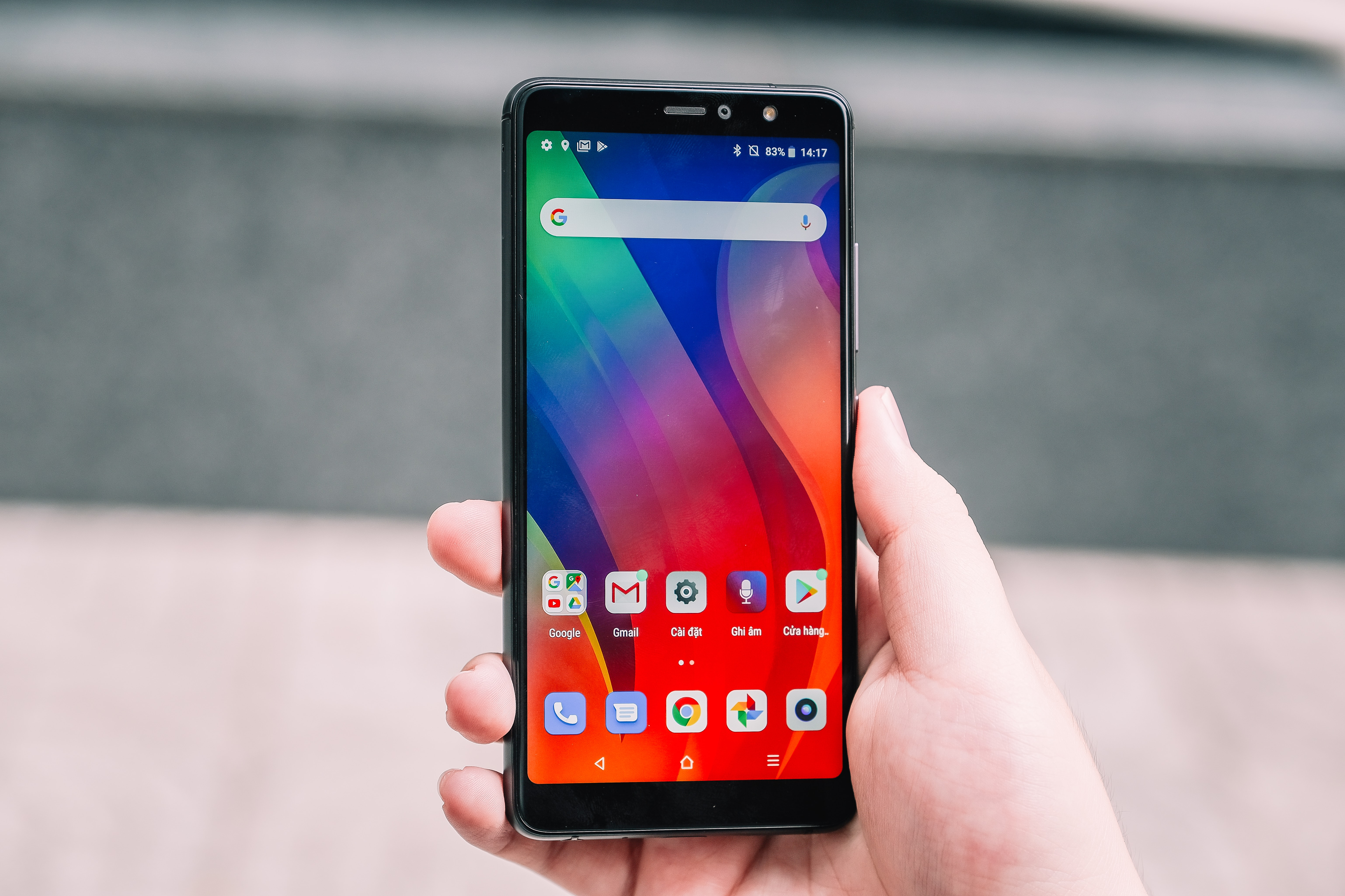 person holding turned-on black Android smartphone