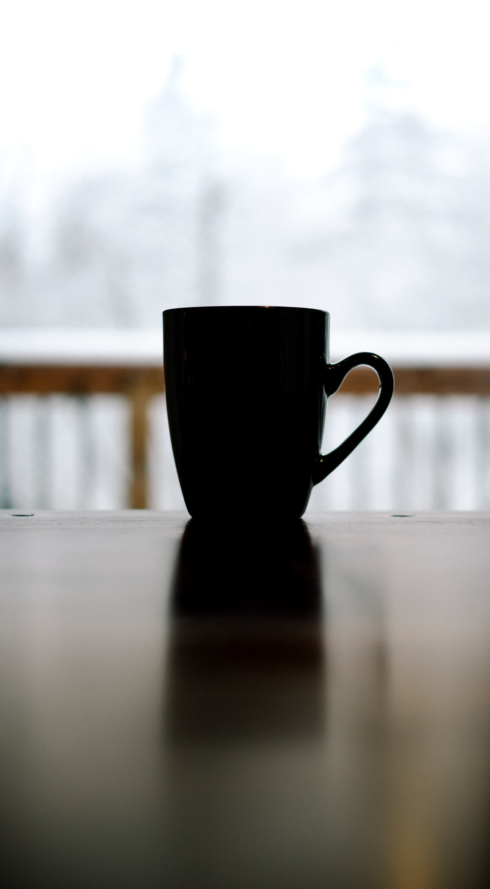 black ceramic mug on top of table