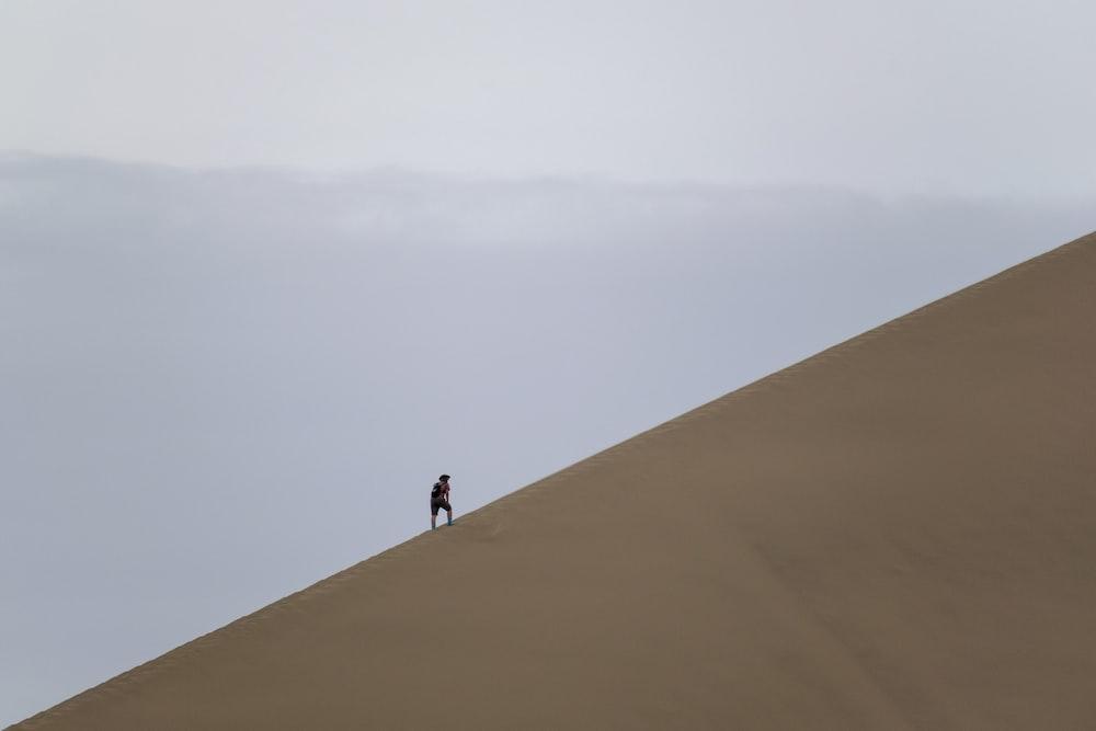 person climbing desert