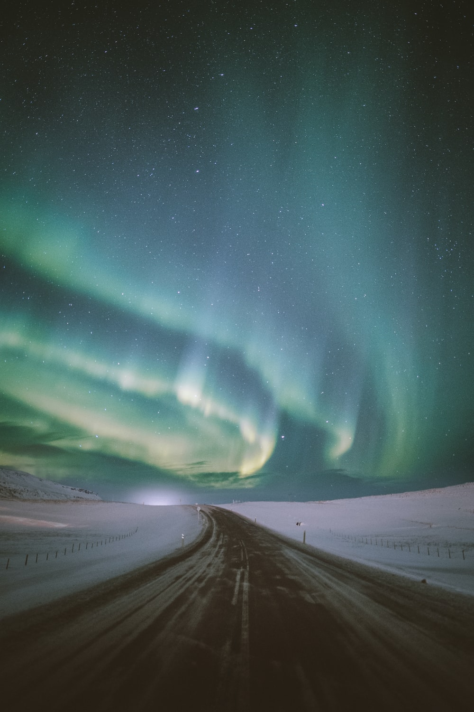 empty road under aurora phenomenon
