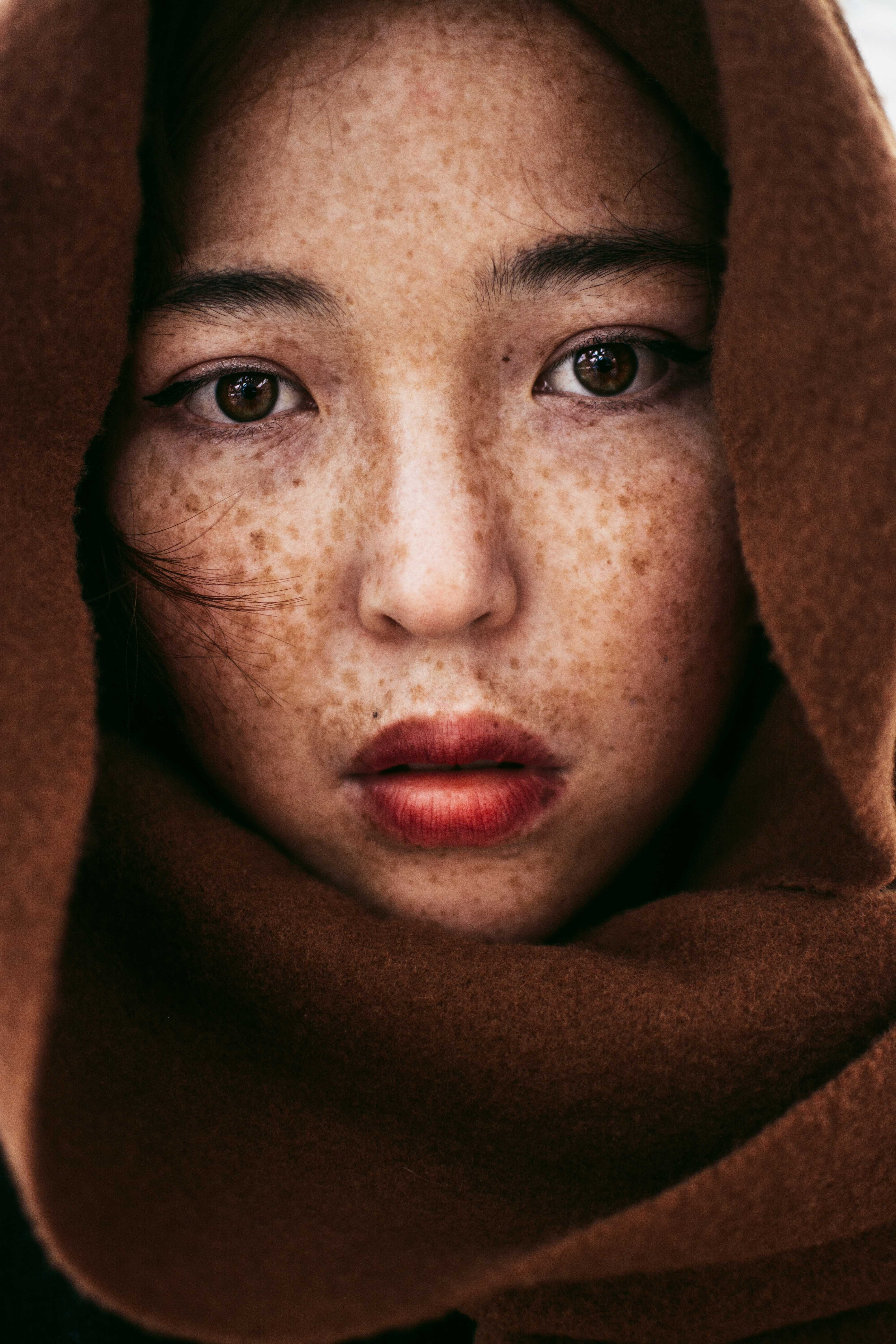 woman wearing a brown scarf