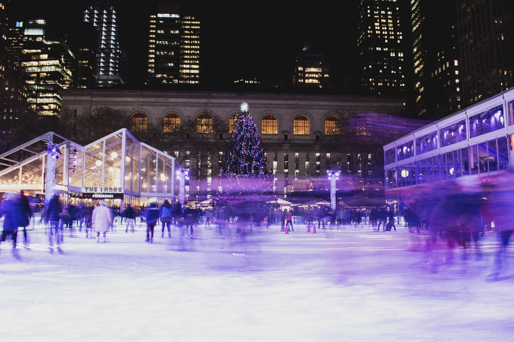crowd on ice rink during night