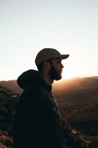 silhouette photo of man overlooking mountains