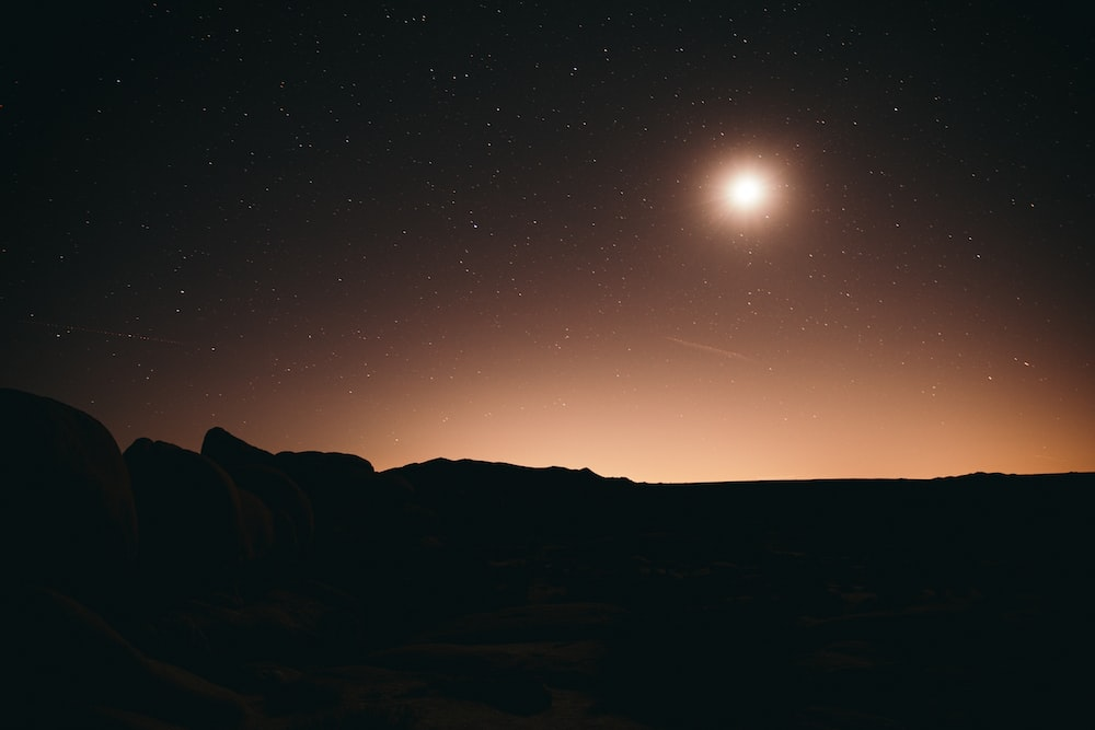 full moon over mountains