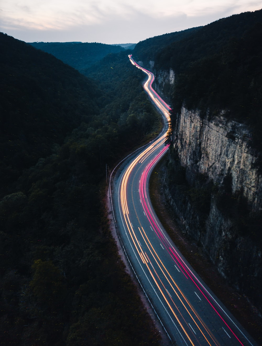 panning photo of lighted road