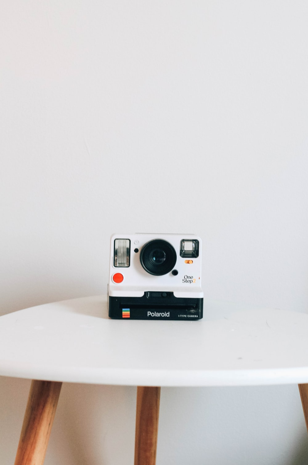 black and white Polaroid camera on top table