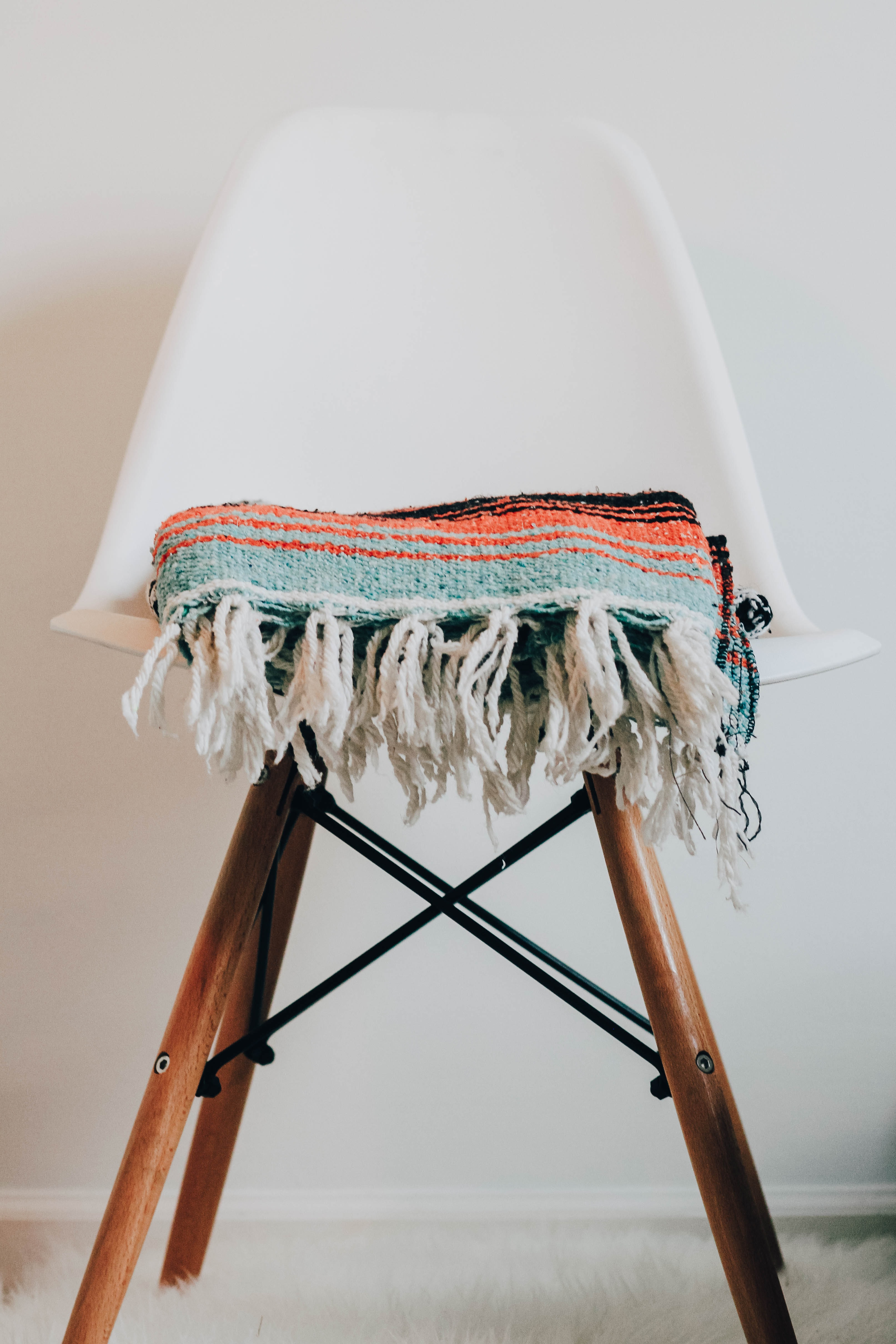 teal knit scarf on chair