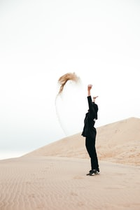 woman throws sand