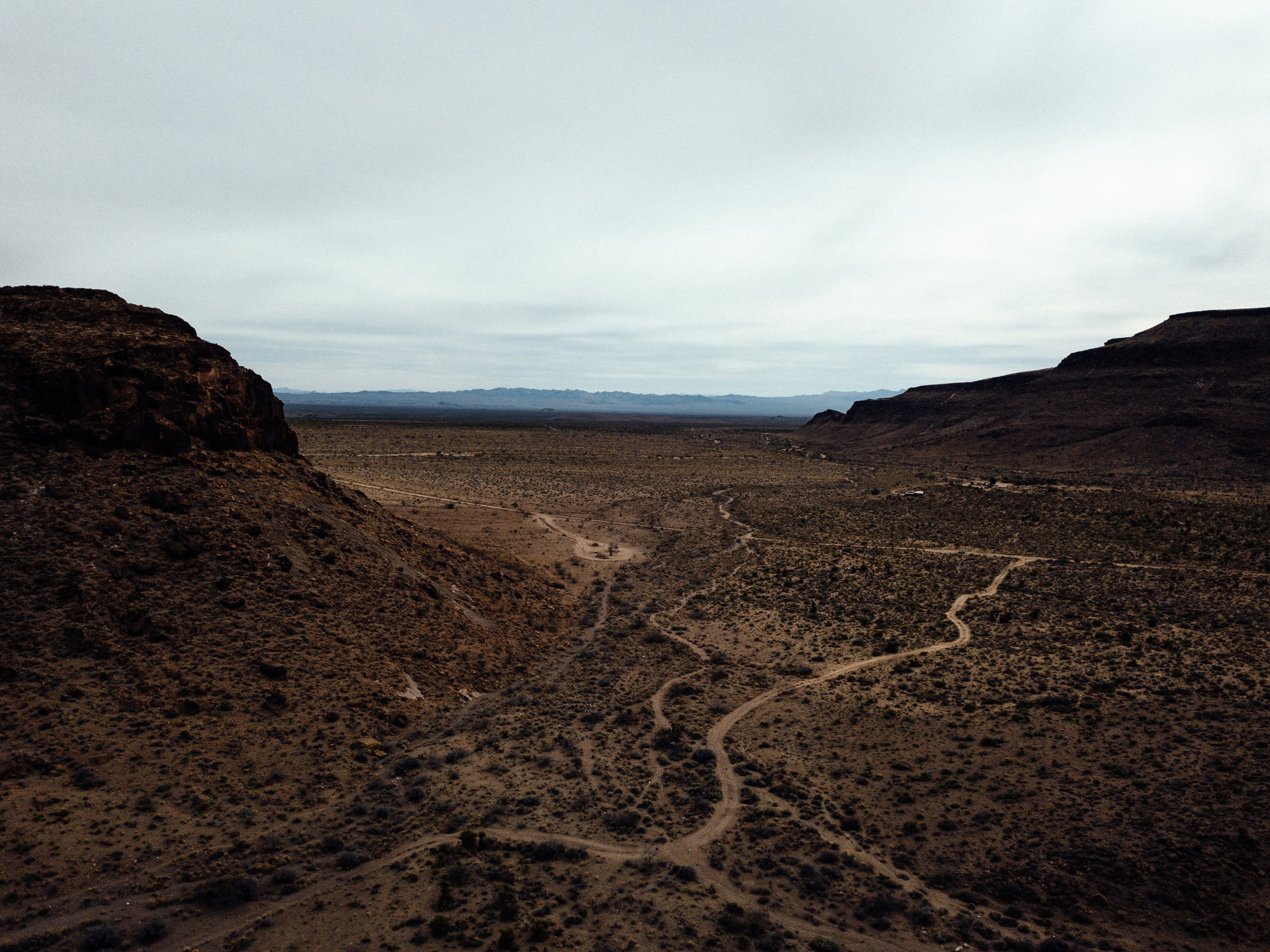 aerial photography of desert mountains during daytime