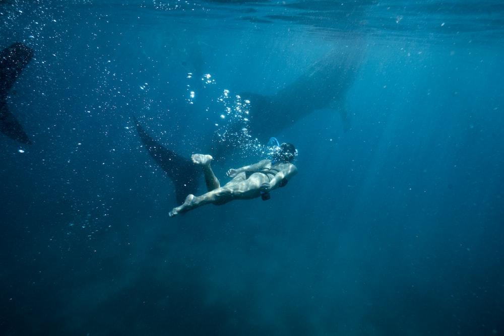 woman under water photo