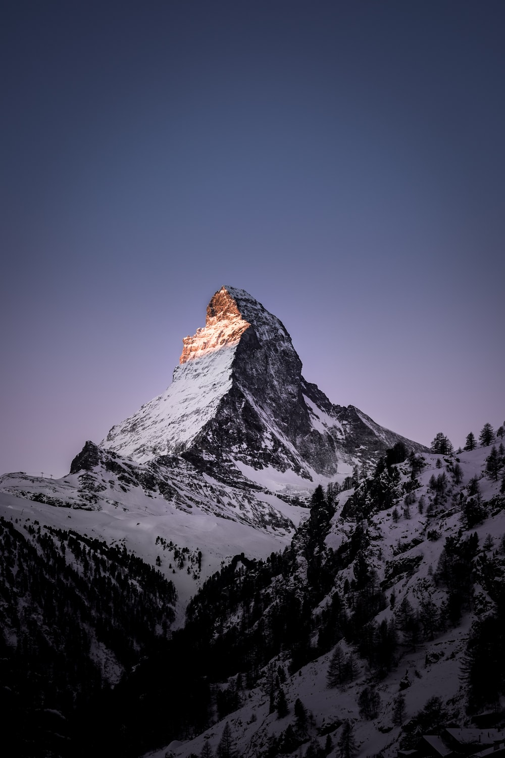 mountain coated with snow