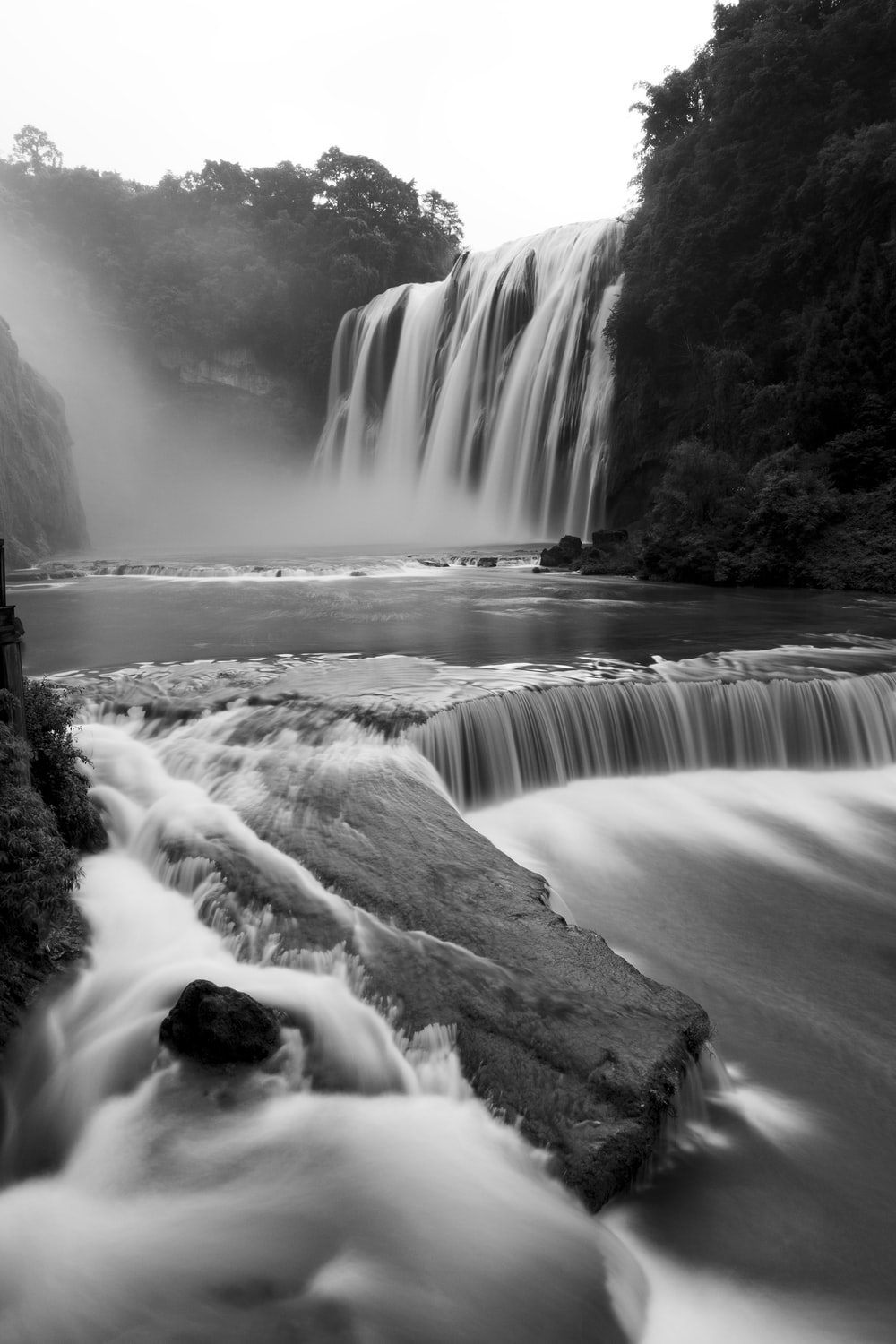 grayscale photography of waterfall