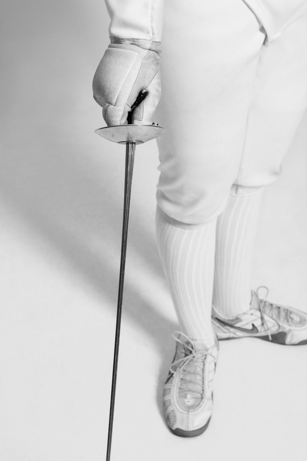person holding fencing sword