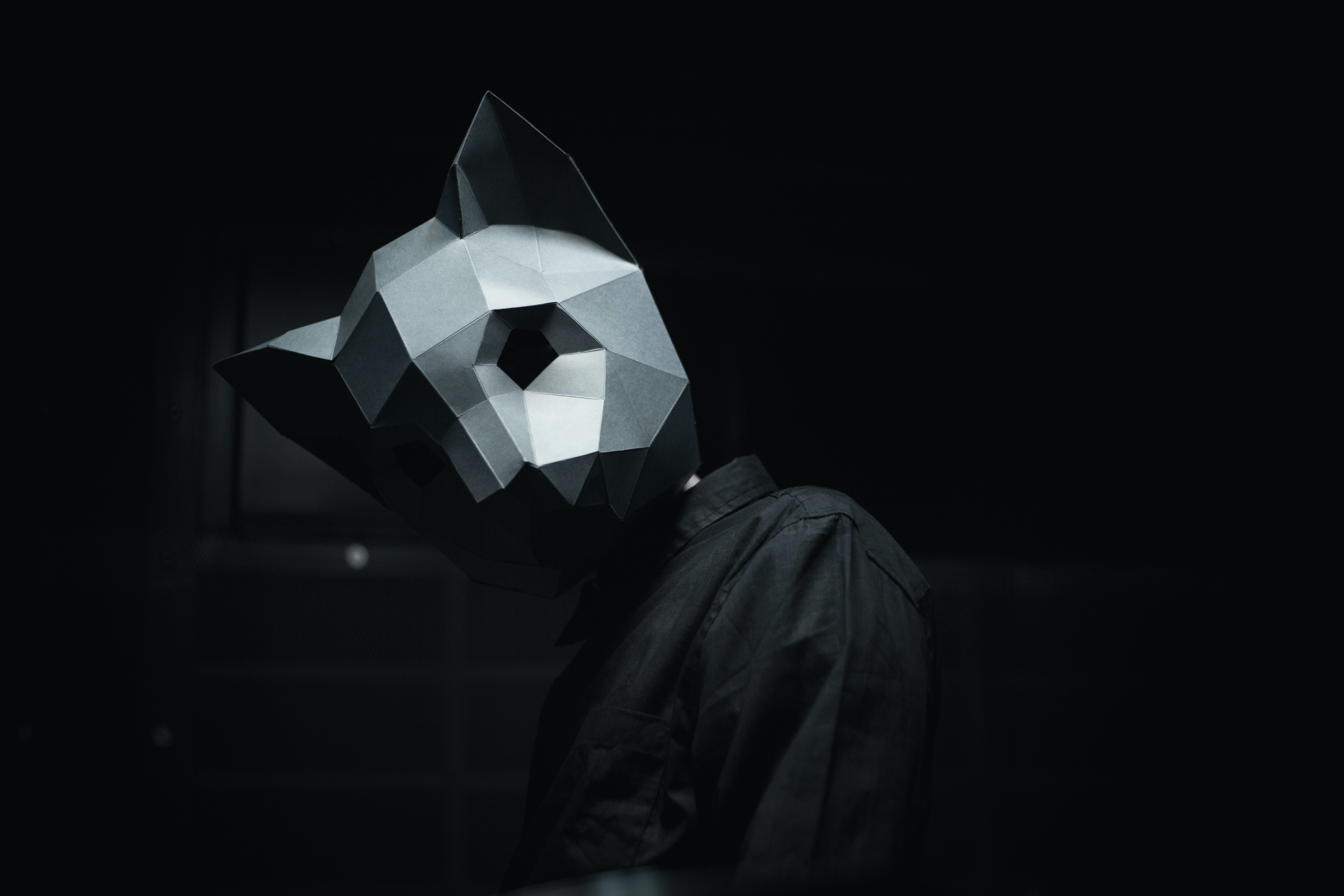 person wearing gray mask