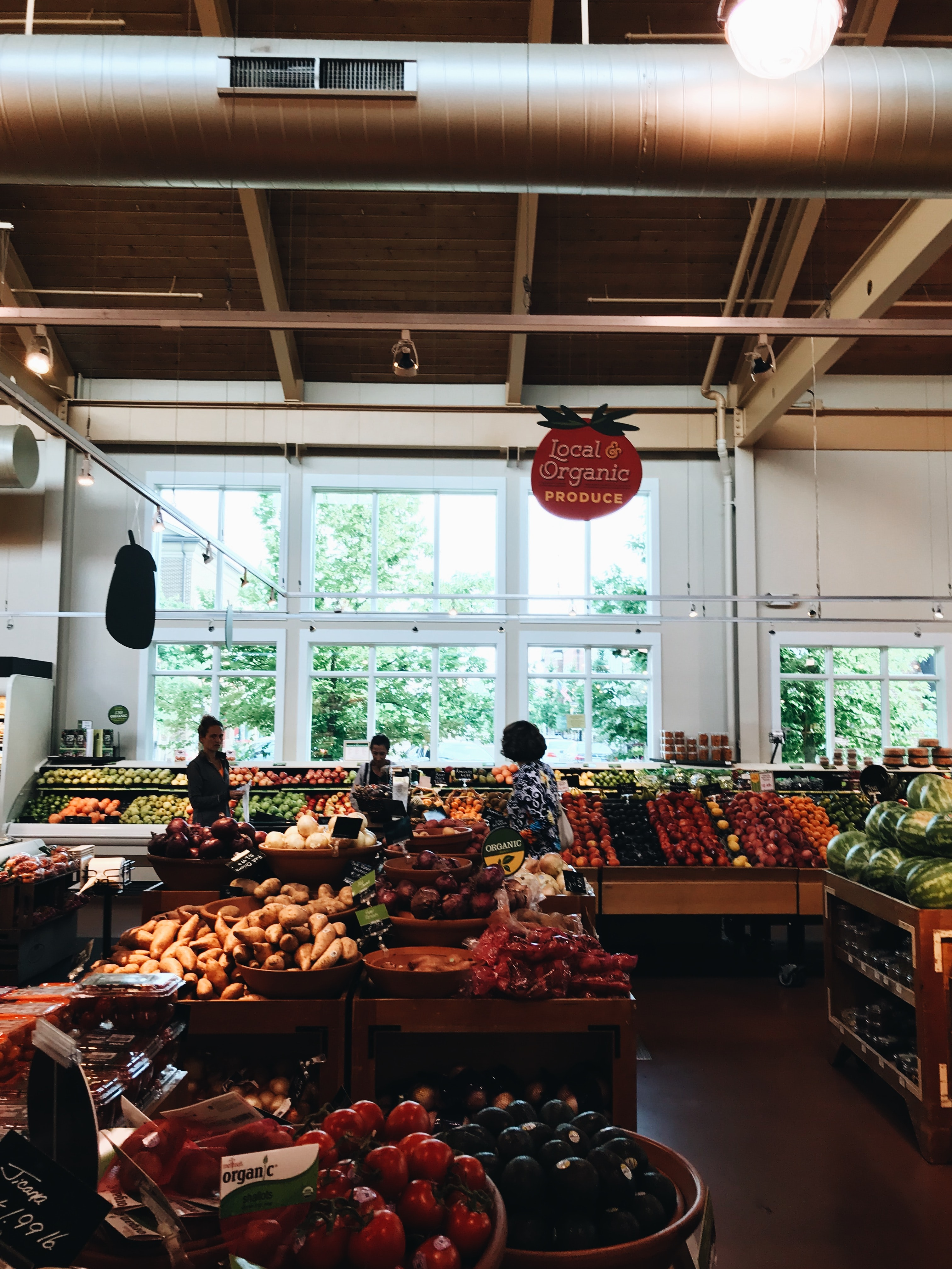 group of people inside mart at fruit section