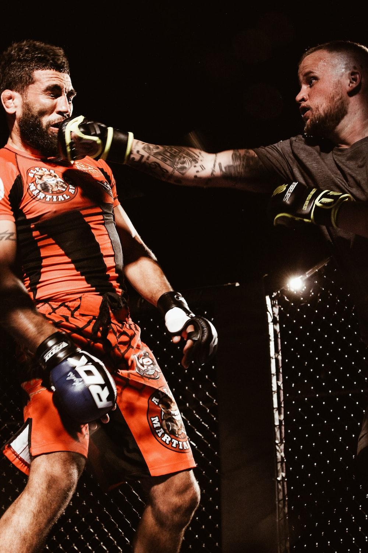 two men playing UFC inside ring