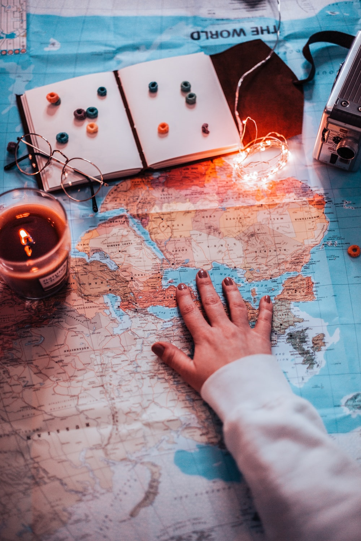 person touching world map