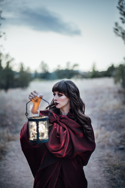 woman carrying camping lantern
