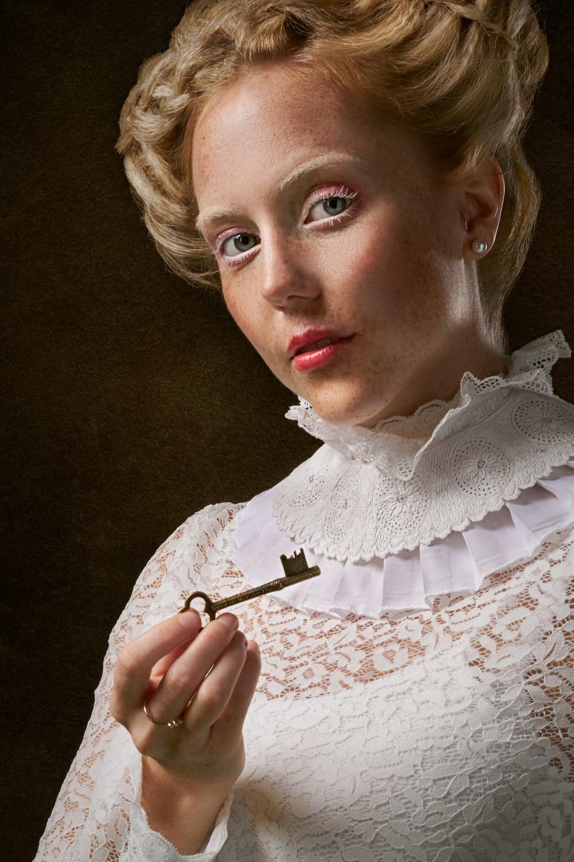 woman holding skeleton key