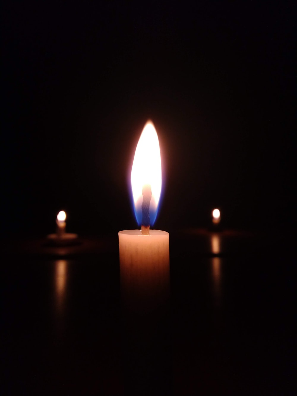 shallow focus photography of candle