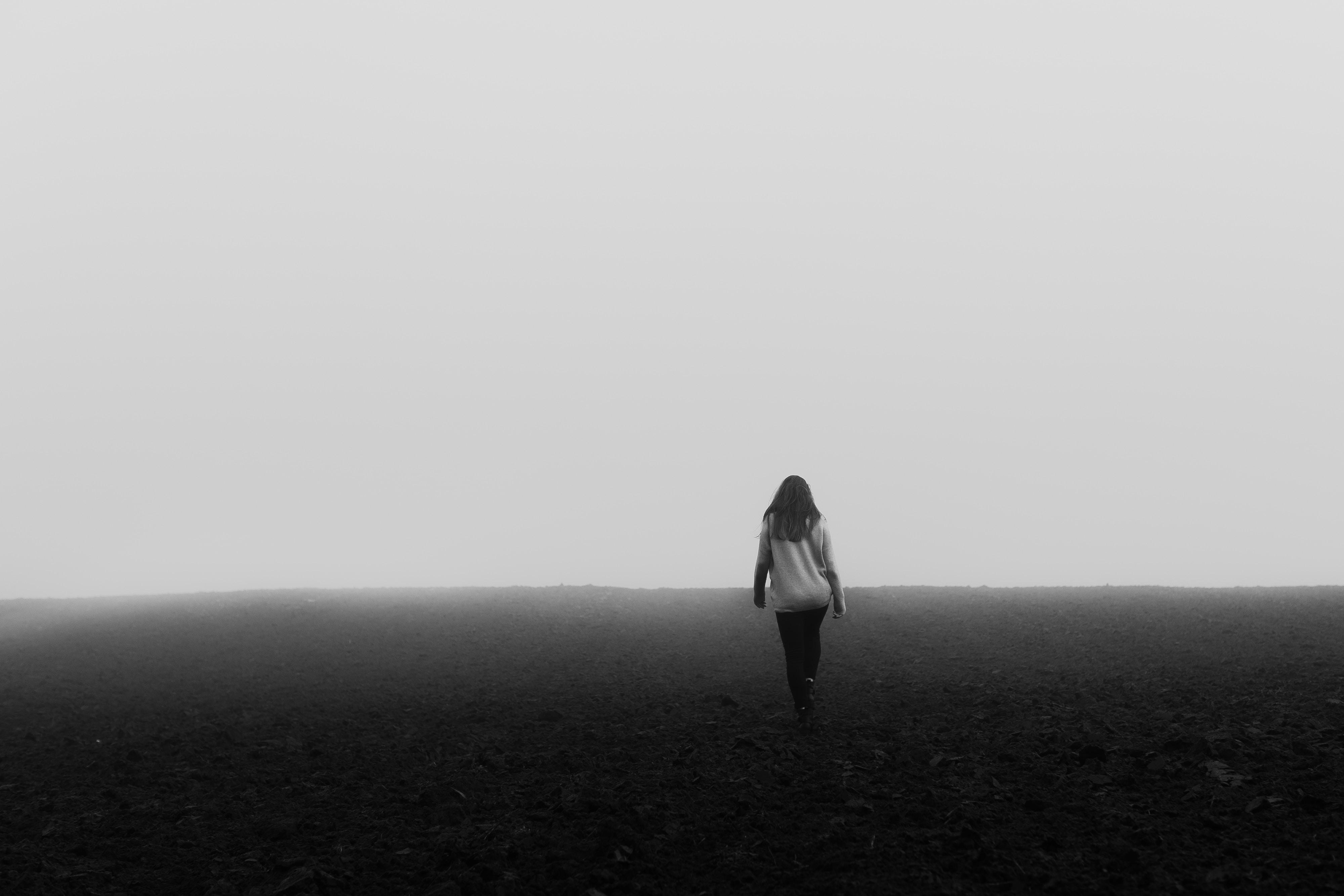 woman walking on black surface