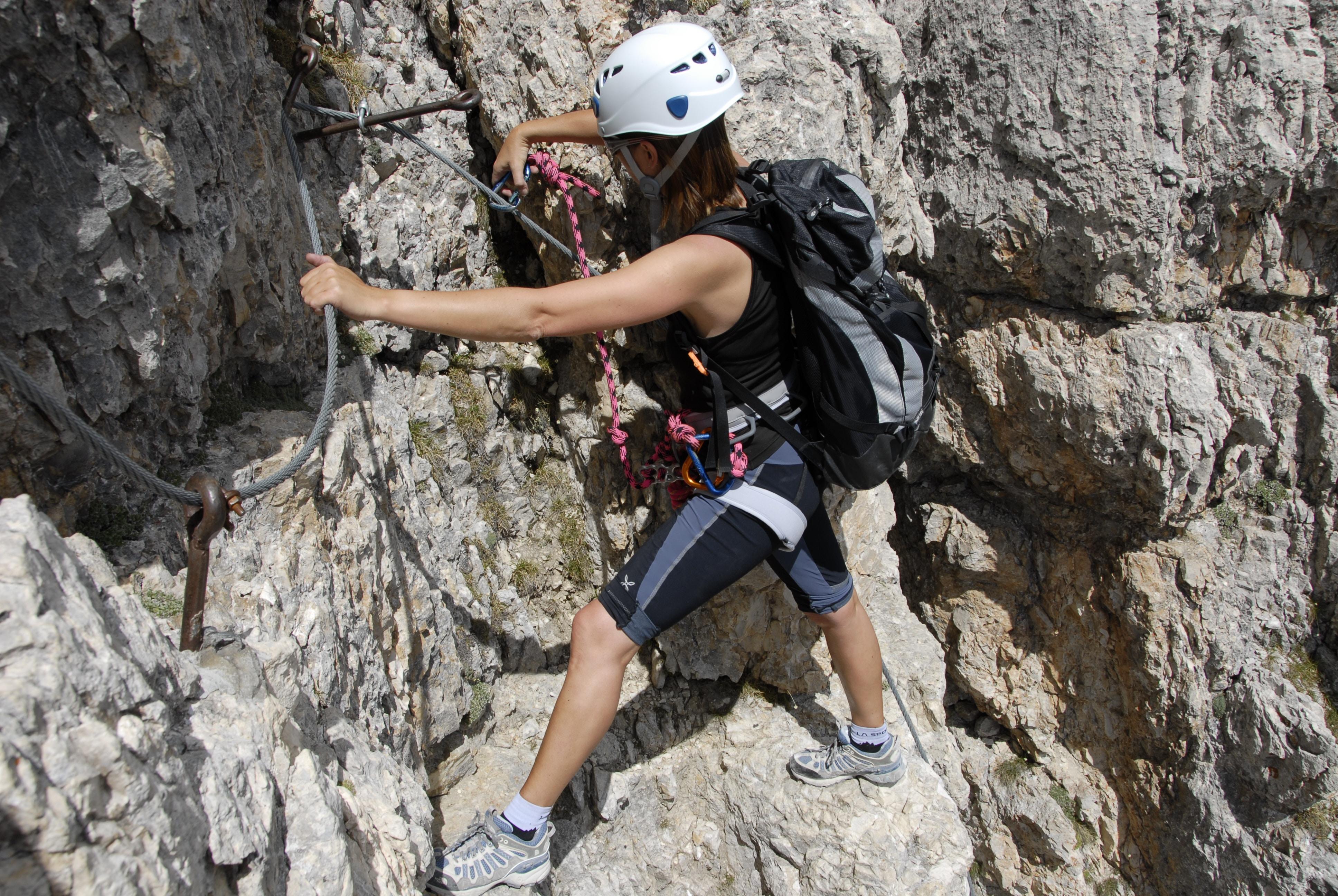 woman climbing cliff