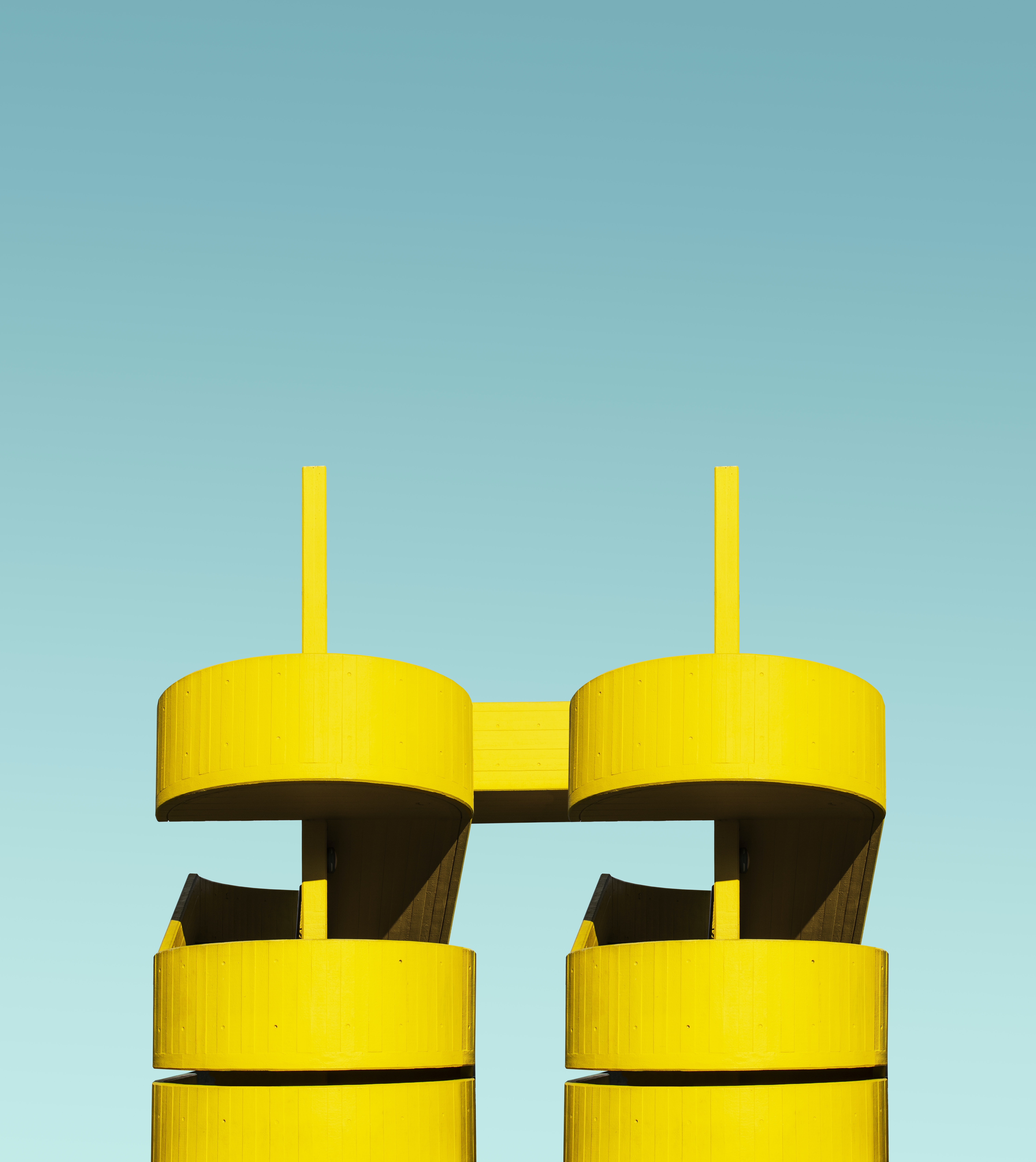two yellow pilar towers close-up photography