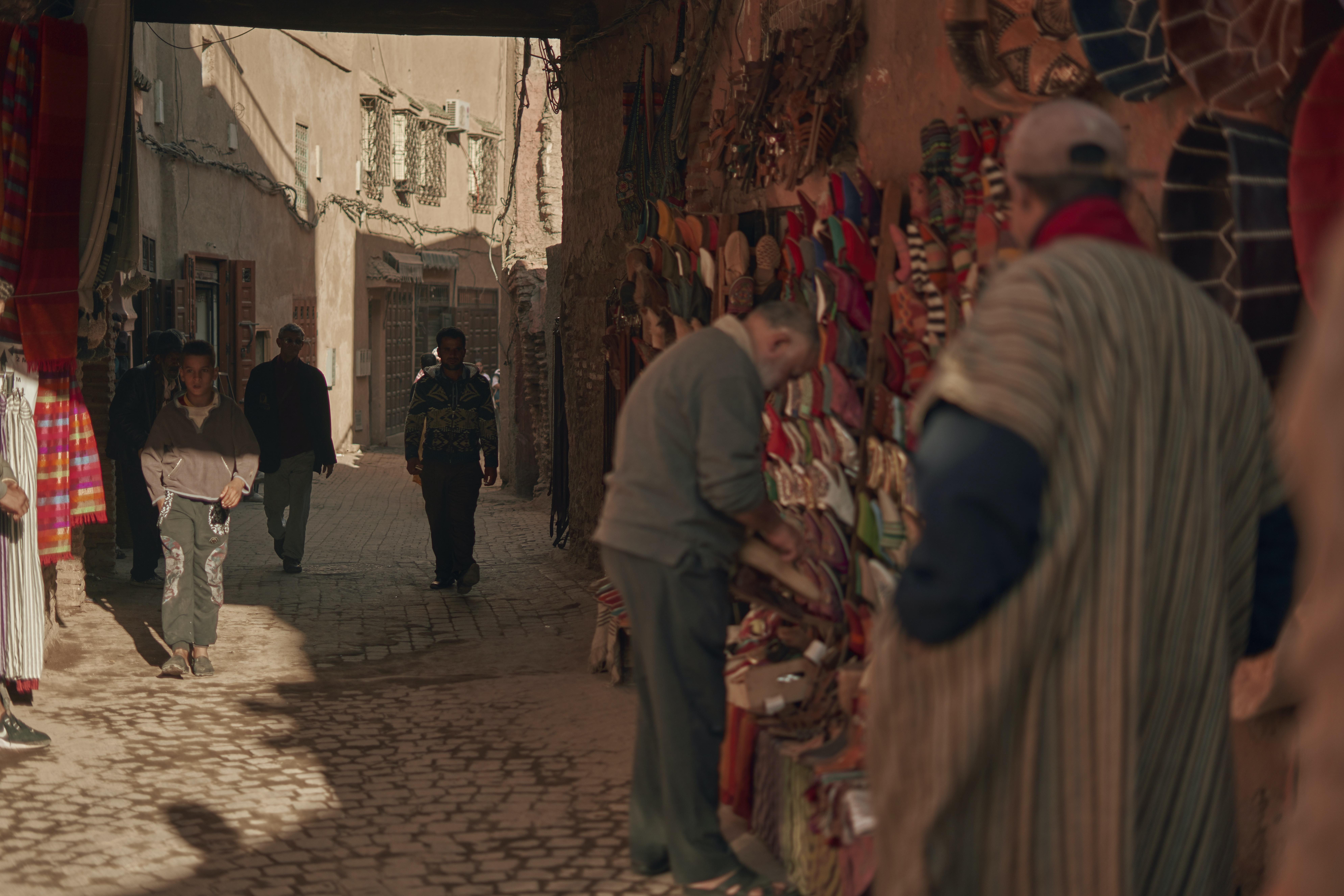people walking on market in town